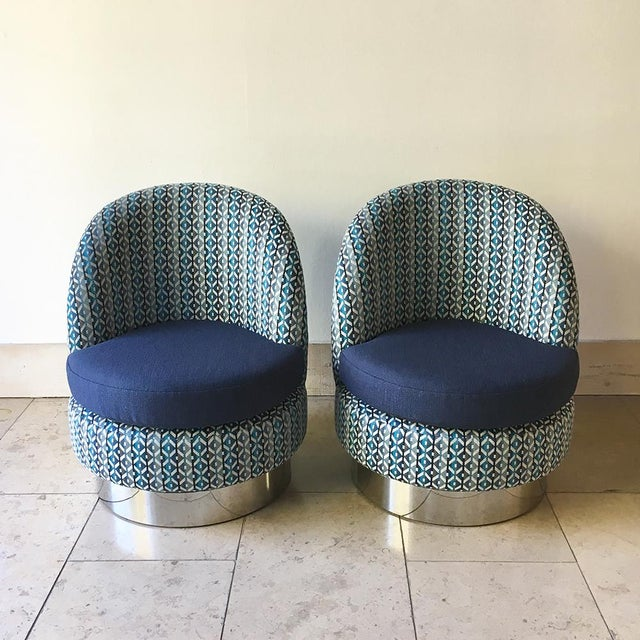 A Standard Pair of Two Tone Upholstered Swivel Chairs on Steel Bases by Talisman Bespoke This compact but comfortable...