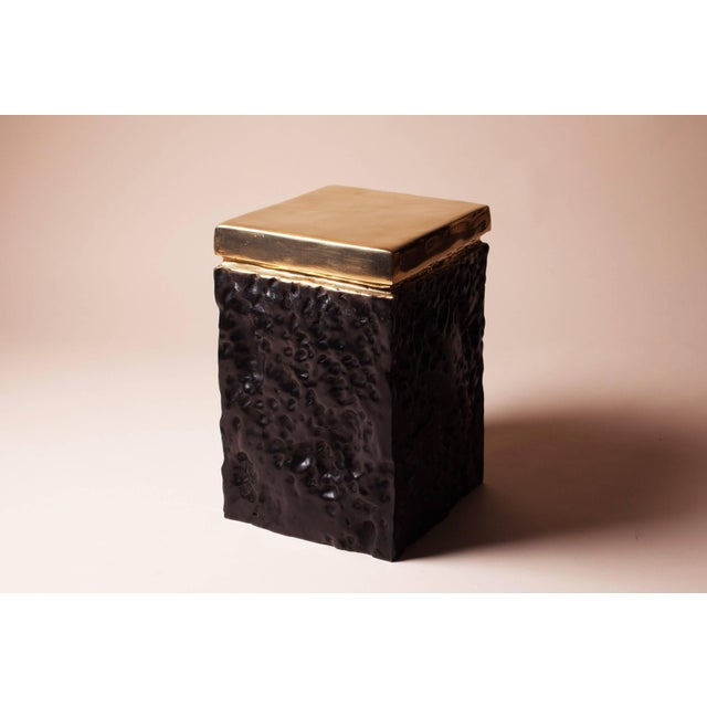 Extraordinary hand casted bronze stool with bottom black detailing Extremely decorative piece that can be used as a...