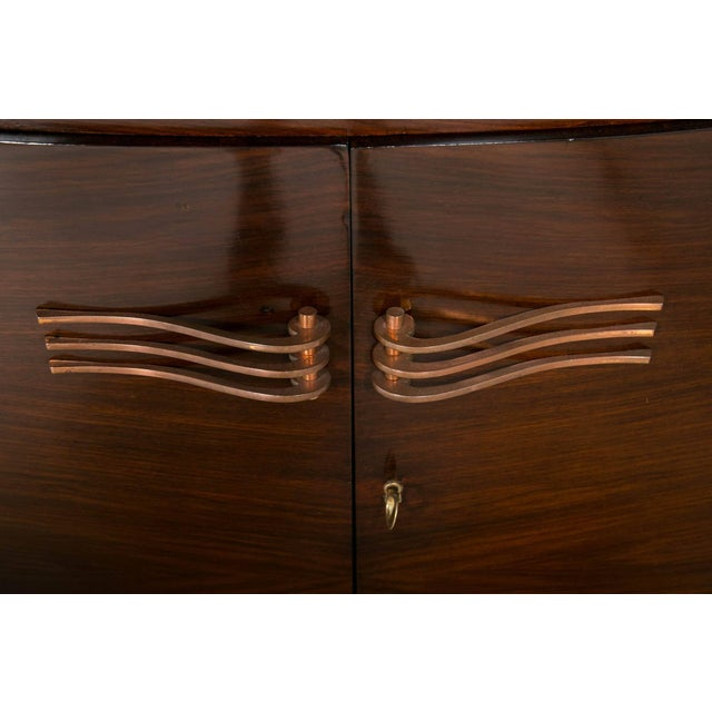 French 1935 Art Deco rosewood sideboard with bow fronted design.