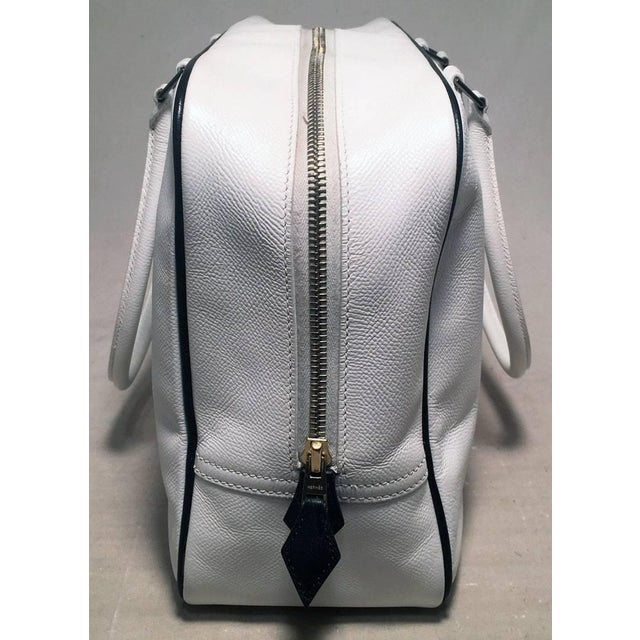 Gorgeous Hermes Black and White Plume 32cm Tote Handbag in excellent condition. White veau grain leather trimmed with...
