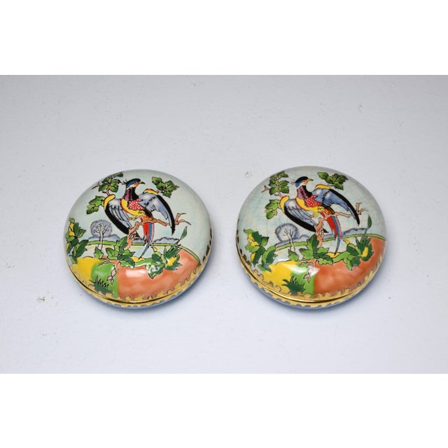 Set of two vintage porcelain boxes crafted by notable French Emaux de Longwy pottery workshops from the Romance...