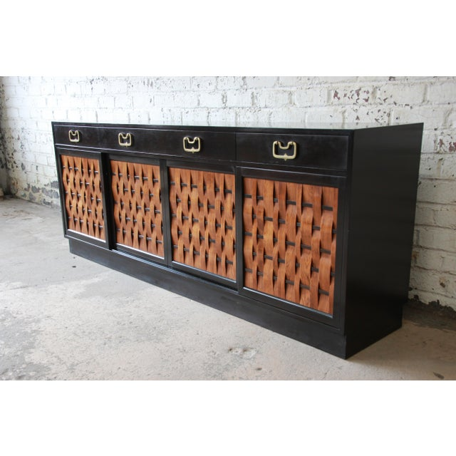 Offering a rare and outstanding mid-century modern woven front sideboard or credenza designed by Edward Wormley for Dunbar...