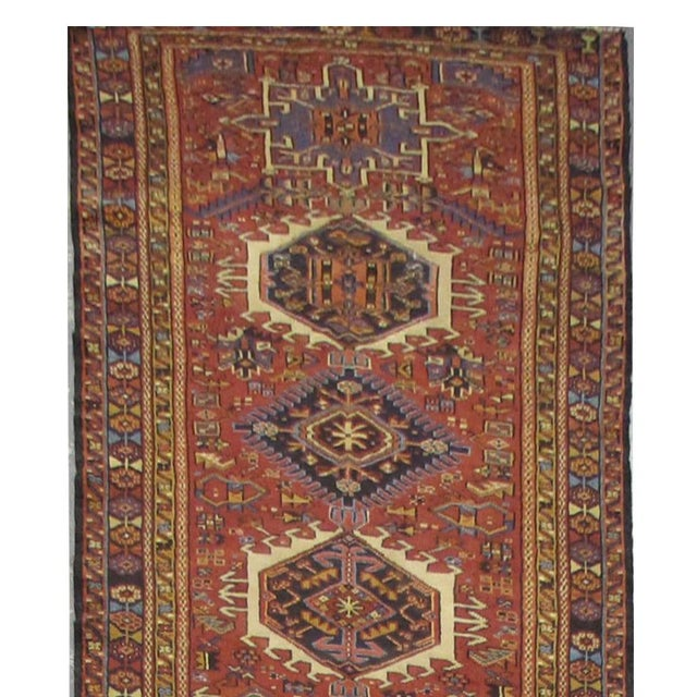 This beautiful rug is hand made, made in Iran. It features a pattern in a vibrant combination of red, navy,blue, purple,...