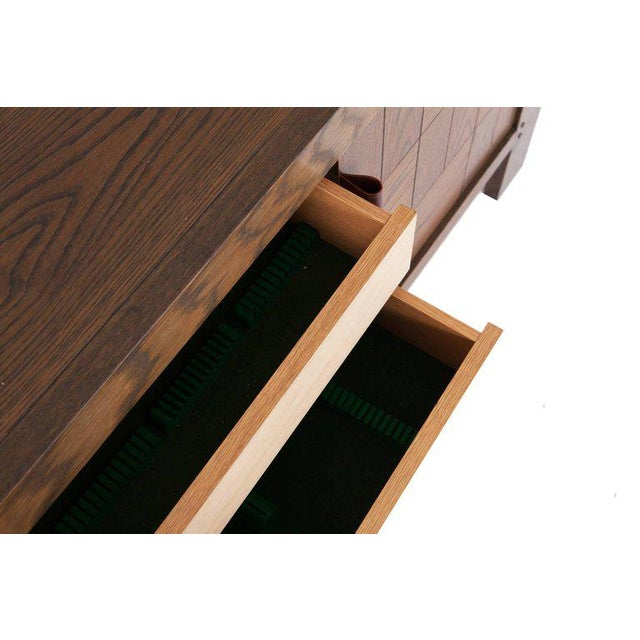 Scarpa style, large brutalist credenza. The cabinet is provided with graphic door panels with stained oak inlay and...