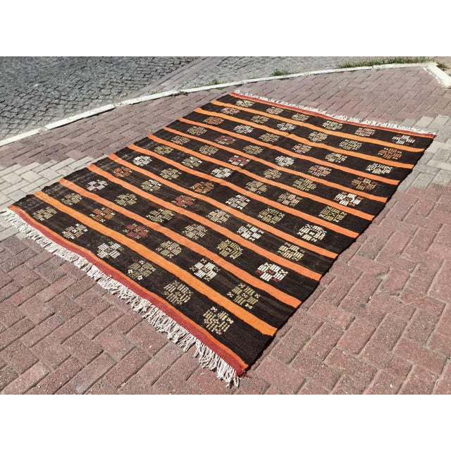 This beautiful, vintage, handwoven kilim is approximately 60 years old. It is handmade, of very fine quality hand spun...