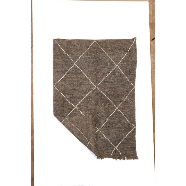 Vintage, one of a kind, original Beni Ourain Moroccan rug, hand-woven by women in the atlas mountains.