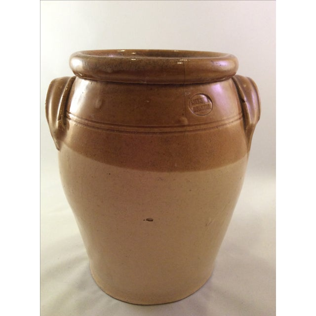 An 1890's English Stoneware Crock with tan glazed rim and handles. Maker's stamp Melsom Bristol England.