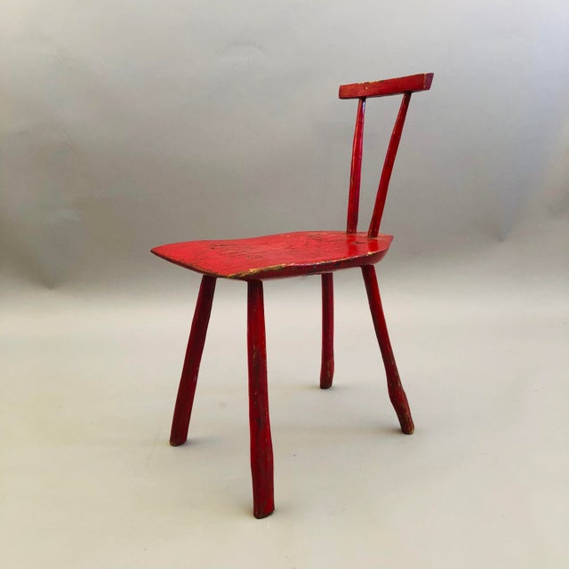 Hand hewn folk side chair with red painted finish.