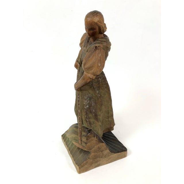 Vintage Art Deco style carved wood sculpture of a woman with a rake working into the ground. No detectable signature.
