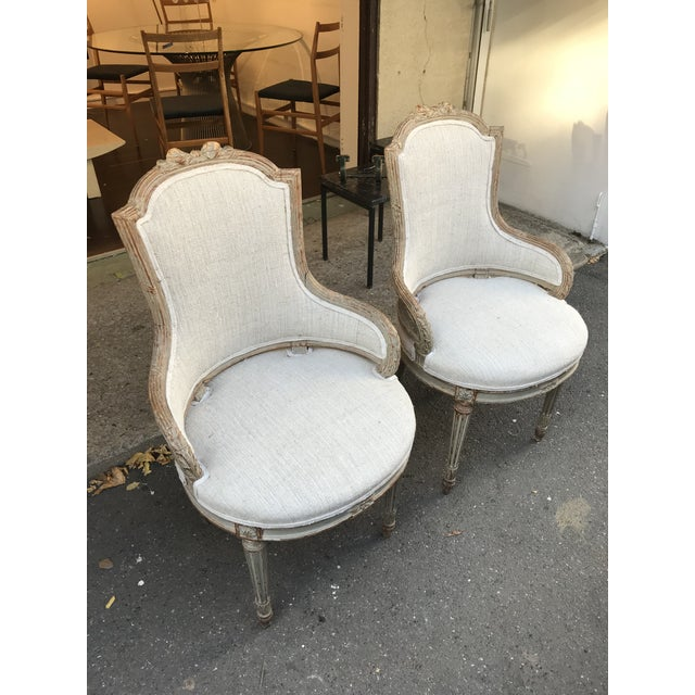 Pair of 1860 French chairs in the style of Louis XVI with a very unique shape. The frames are of hand carved wood with...