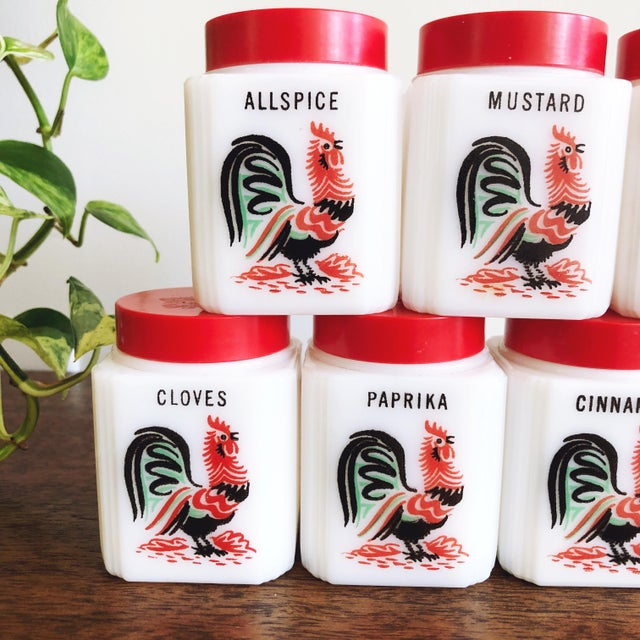 """Lovely vintage set of Tipp City """"Roosters"""" spice jars. This set includes 7 milk glass shakers: ginger, cinnamon, cloves,..."""