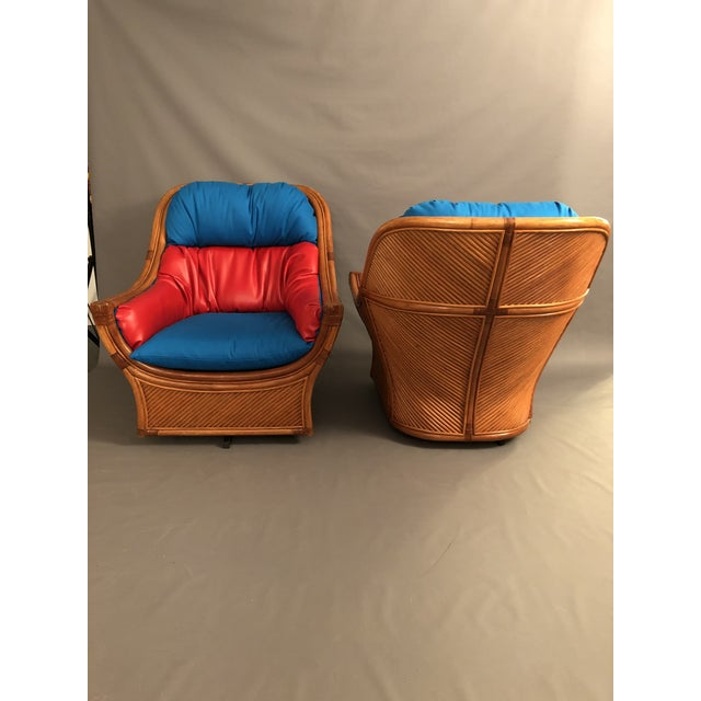 1960s Mid Century Modern Maguires Style Red and Blue Upholstered Rattan and Bamboo Outdoor Swivel Chairs - a Pair For Sale In New York - Image 6 of 11