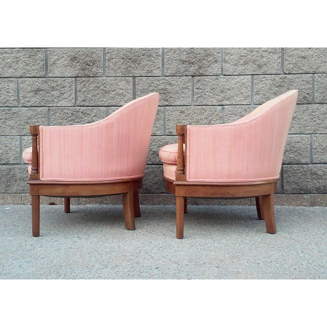 A pair of tub style accent chairs in a Salmon color Dupioni silk or silk like upholstery. These elegant chairs have loose...