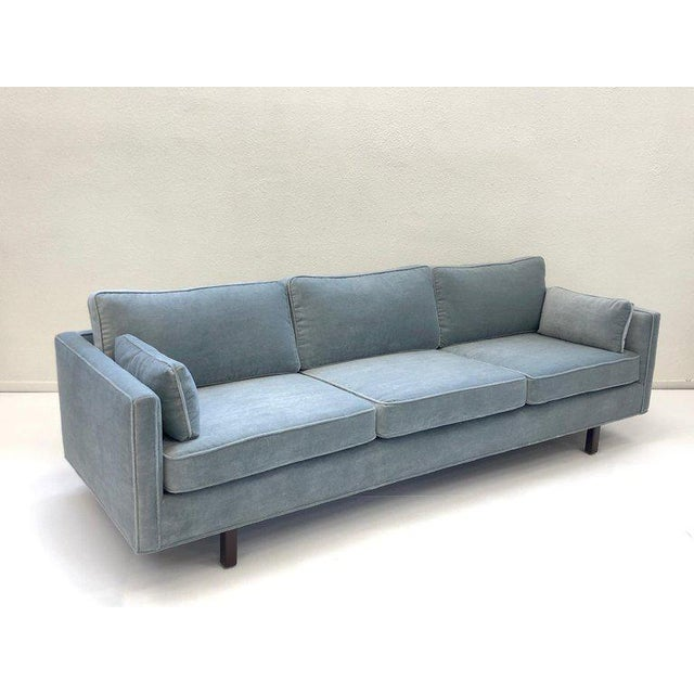 A glamorous 1950s custom Mohair sofa by Carroll Beaupré Interiors. The Sofa has been newly recovered in a soft lite blue...