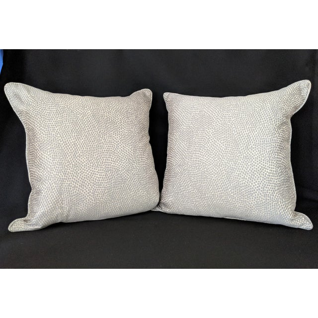 Understated elegance is an apt description for this silver and white pillow pair. The coloring works great with grays,...