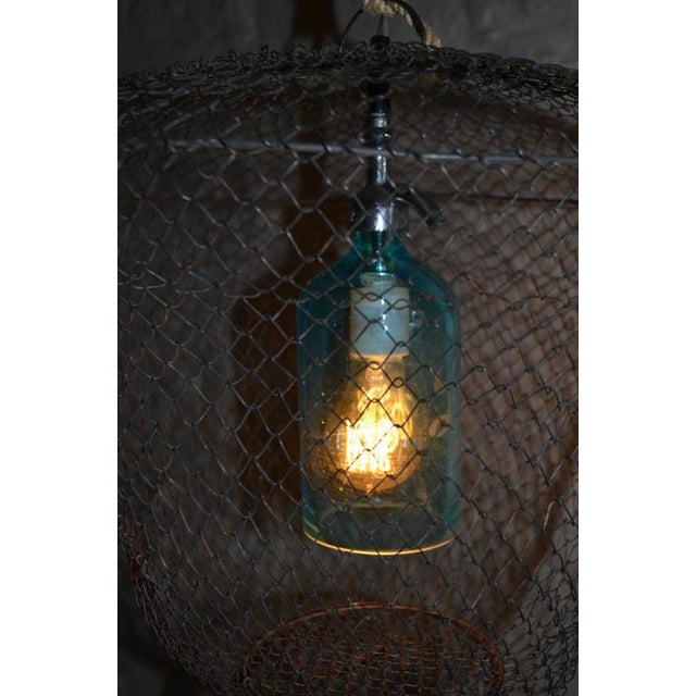 Pendant Light from Seltzer Bottle Suspended in French, Steel Mesh Fish Basket - Image 7 of 11