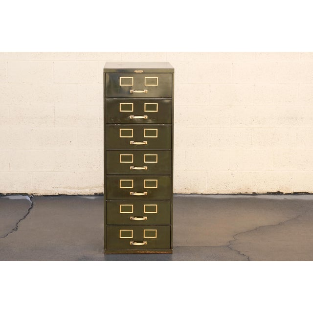 Classic American multi-drawer card filing cabinet by Remington Rand. Industrial era, composed of steel. Original army...