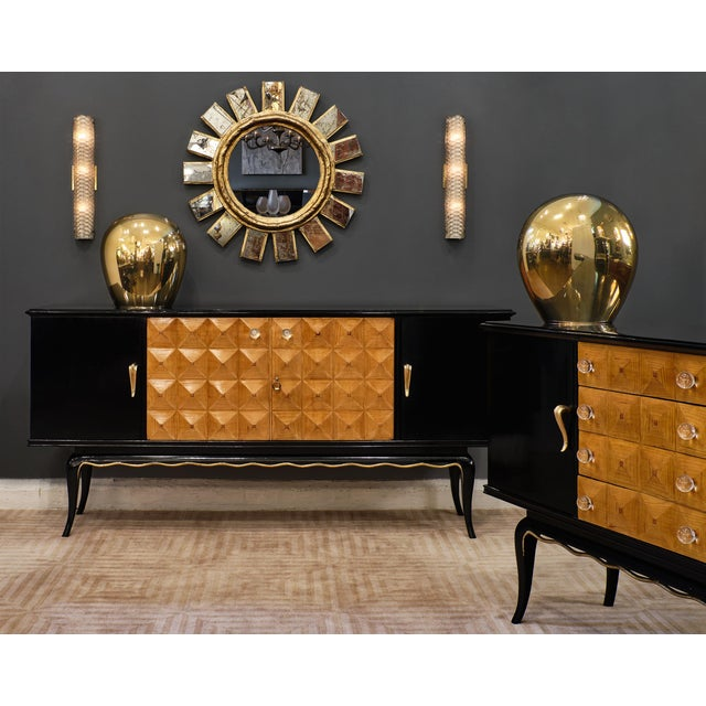 Italian mid-century Buffet with an ebonized body and central doors adorned with a beautiful ash veneer in a diamond...