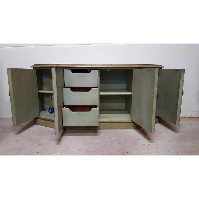 """A solid wood credenza made by Drexel from the """"Esperanto"""" collection. This piece features the original avocado colored..."""