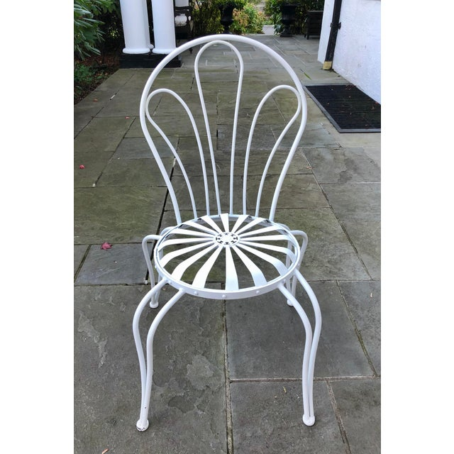 Iconic garden chair from French designer, Francois Carre. Circa 1930s. Professionally powder coated. Seat height is 18...