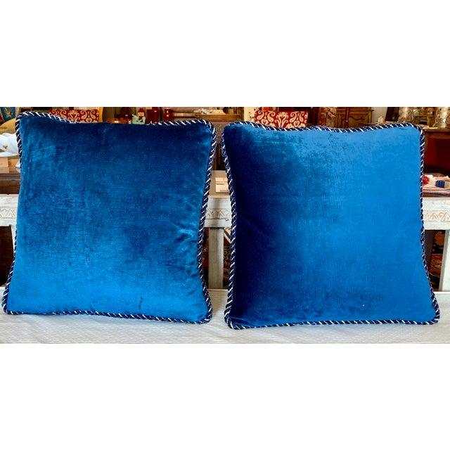 Ultra luxurious Brunschwig and Fils Zambezi gross point indigo and camel cut velvet pillows with blue back. With...