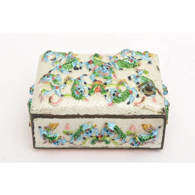 "This remarkable VINTAGE CHINESE "" good luck"" small box has pushed out enamel jumping and leaping frogs and foo dogs in..."