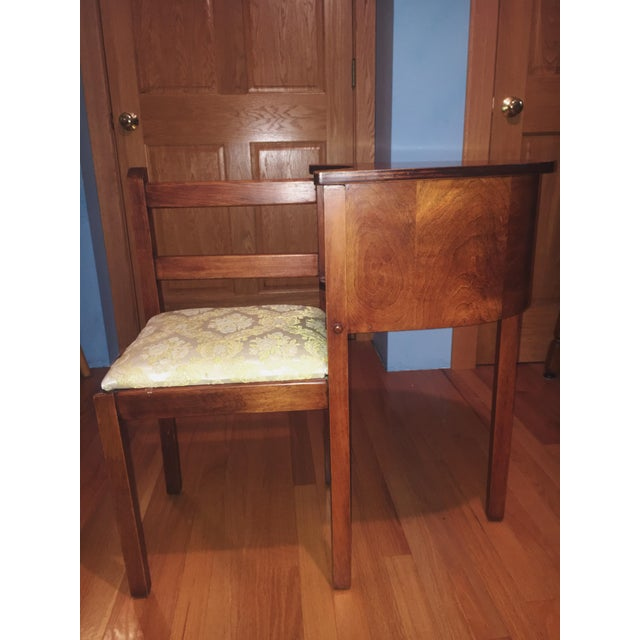 This antique has been around my family for years. Highly cherished, but no longer used. It is a chair with a side desk...