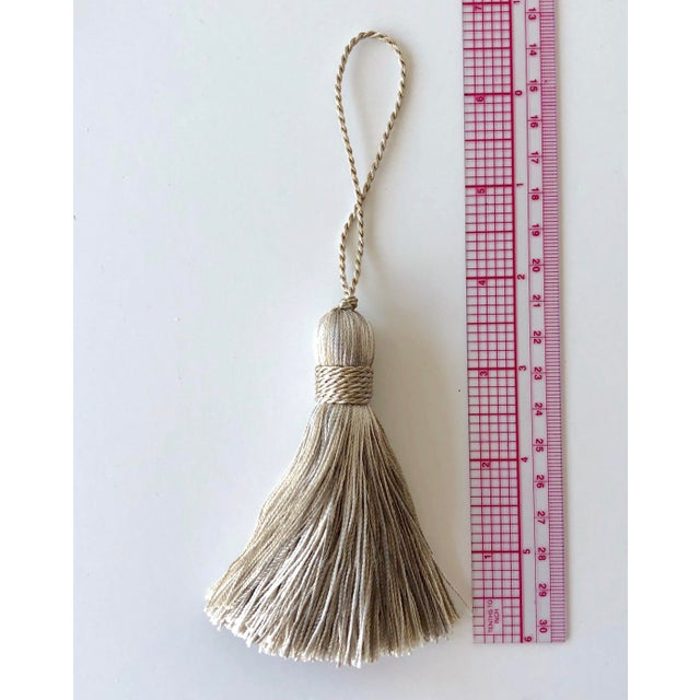 A pair of handmade decorative tassels with a mingle of light neutral colors. Can be sewn into pillow corners, used as a...