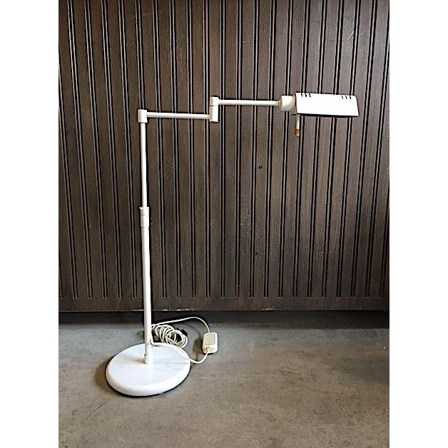 This Holtkoetter adjustable desk lamp is an excellent example of modern design and functionality. There is a dimmer switch...