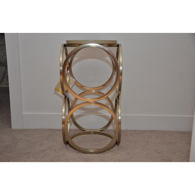 Bernhardt salon accent table features a shagreen wrapped top with a gold plated steel frame in an open circle repeating...
