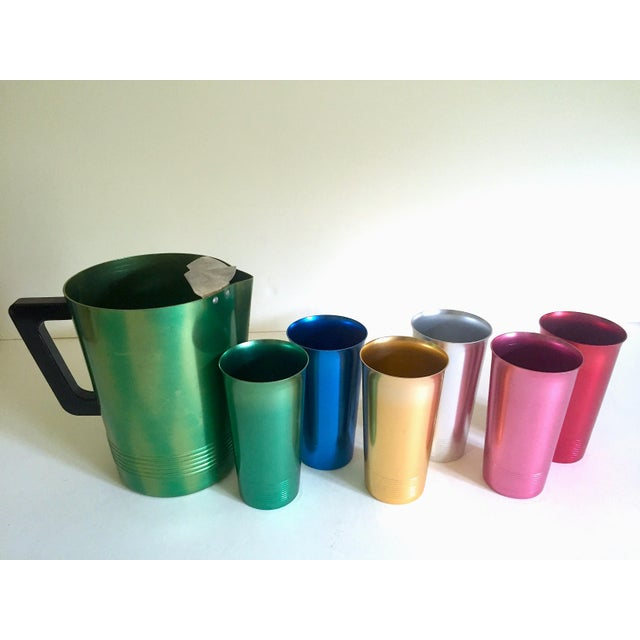 This vintage Mid Century Modern rare anodized spun aluminum multicolor seven piece beverage set is an incredibly special...