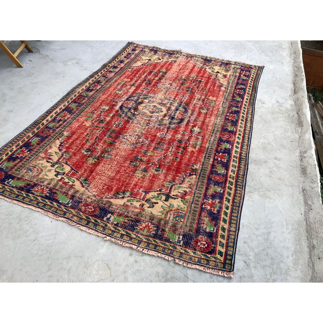 This is a vintage Turkish handwoven Anatolian OUSHAK rug. We collect old vintage antique rugs from Anatolia, which is the...