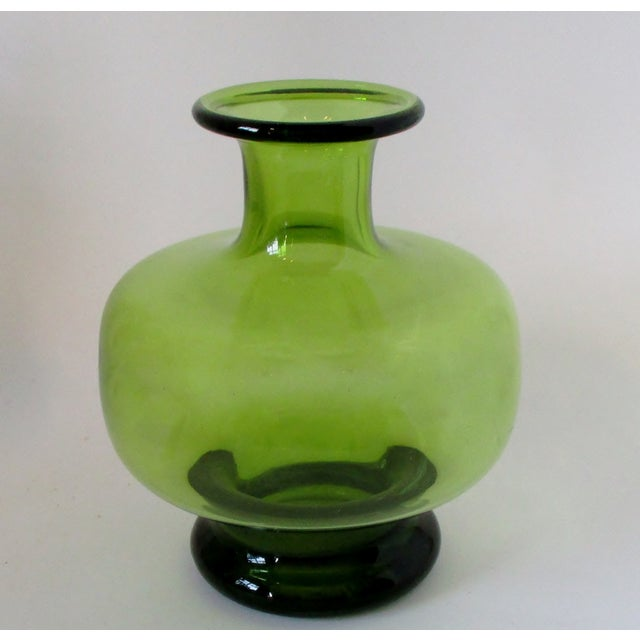 Green Holmegaard blown glass bottle-shape vase by Per Lütken, dated 1961, from the artist's Safir series. Etched signature...
