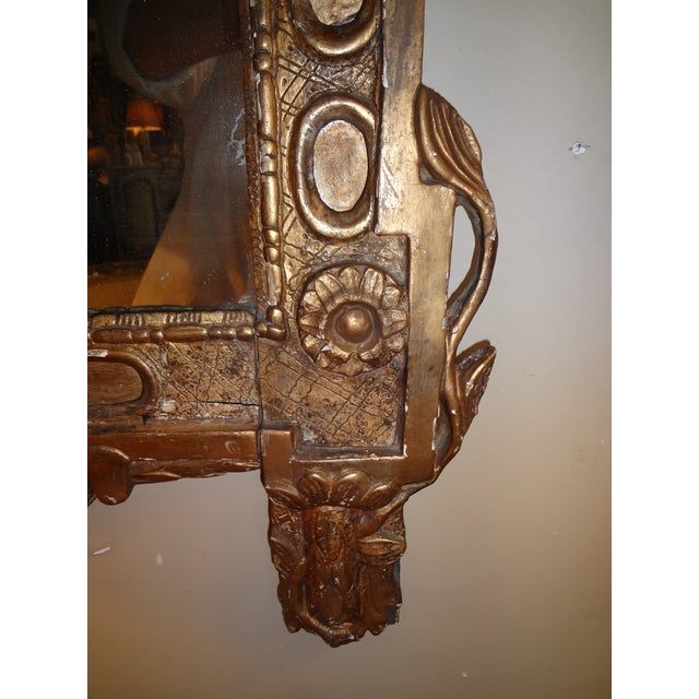 Amazing carving on this antique mirror. Flower medallion. Urn and flame top with swags.