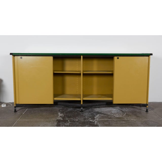 """Part of the """"Spazio"""" series, this 1950s Italian credenza by Olivetti features emerald-colored leather top with chartreuse-..."""
