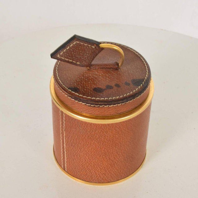Vintage Hermès style leather and brass cigarette holder. Italy, 1950s.