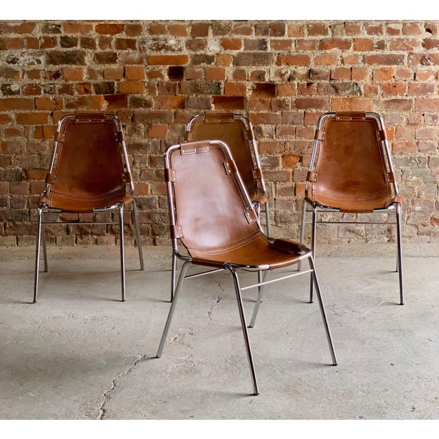 Dining chairs leather four Les Arcs 1970s original. Fabulous set of four tan leather 'Les Arcs' dining chairs manufactured...