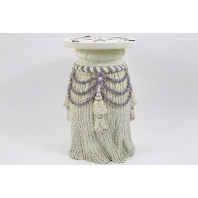 A vintage, plaster side table or stool, with a dimensional rope and tassel design.