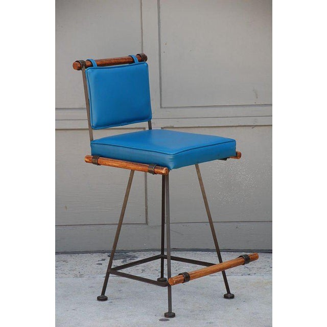 Comfortable Wrought Iron and Oak 50's Swiveling Bar Stool. 25.5 in. seat height.