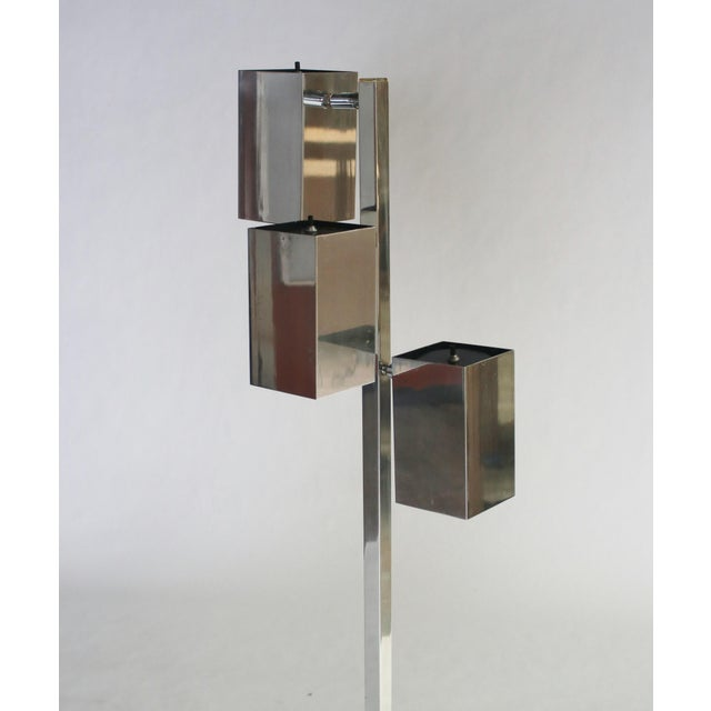 Mid-century modern 3-can chrome floor lamp by Koch and Lowy. Each cubist atriculated light can be adjusted into various...