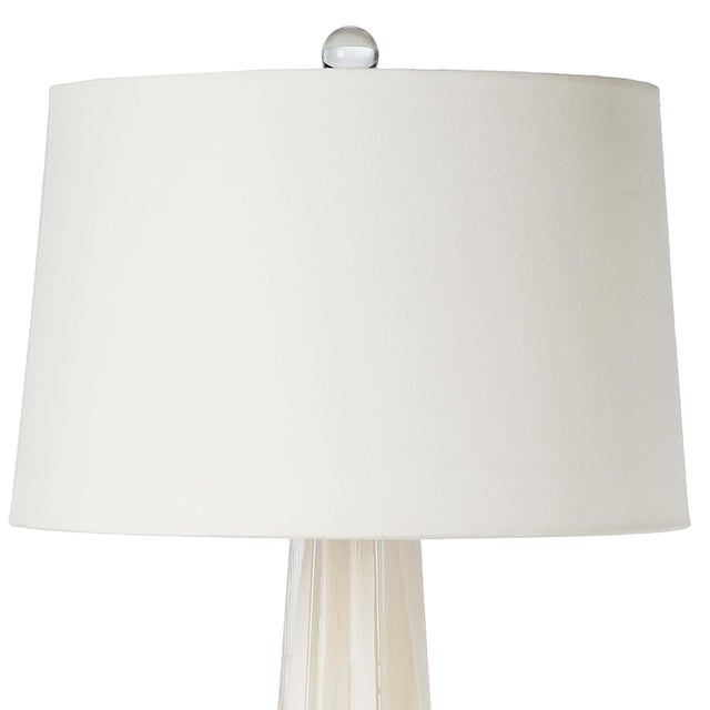 Featuring a crisp white glass finish formed in a star silhouette, the Glass Star table lamp has endless contemporary...
