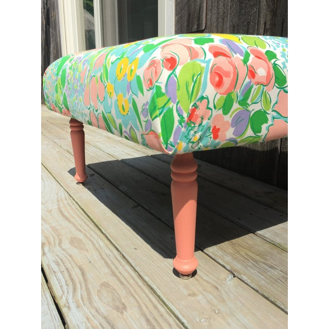 Newly re-made one of a kind floral ottoman. This chair is bursting with joy. Legs are solid hardwood from an antique...