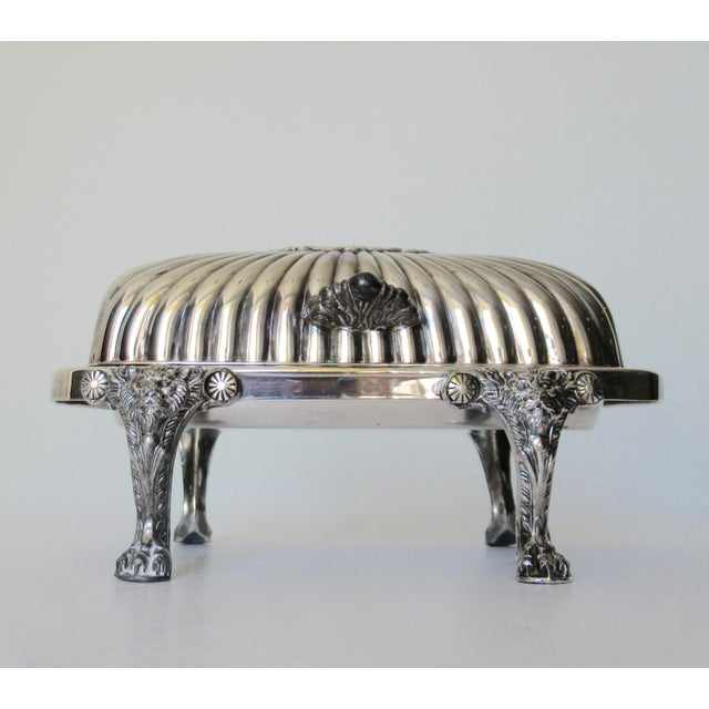 Vintage; F.B. Rogers Silver Company, silver over copper, platform, footed butter dish, with emblazoned lion and claw feet...