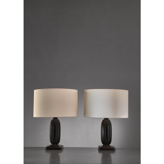 A pair metal table lamps by Danish designer Ib Just Andersen (1884-1943). The lamp is made of Disko metal; an alloy of...