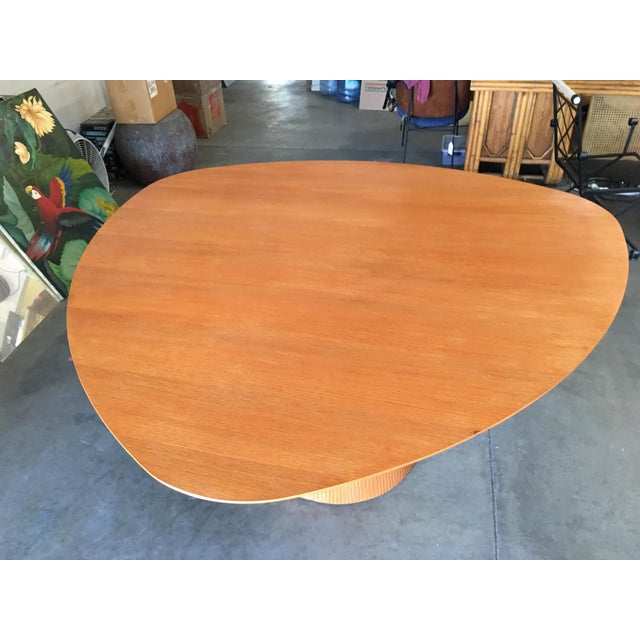 "Large 61"" diameter guitar pick dining table featuring a stylized ""Knife Edge"" resting on a single tapped lined table base...."