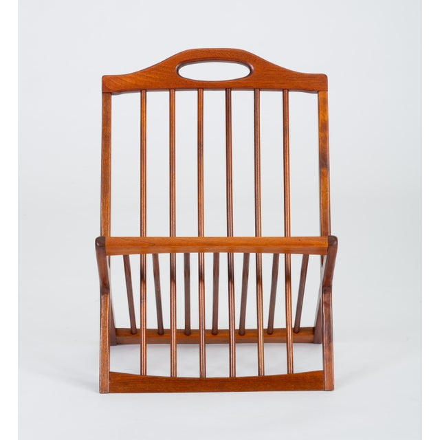 A walnut magazine rack from the late 1950s by Arthur Umanoff for New Jersey-based Washington Woodcraft. Formed by two...