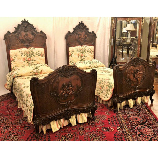 Pair Antique French Museum Quality Walnut Beds, Circa 1860-1880. One of the finest examples of wood carver's art of the...