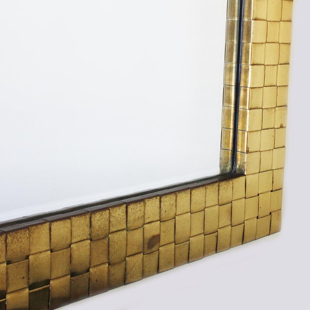 This is a brass woven Chapman mirror circa 1970.