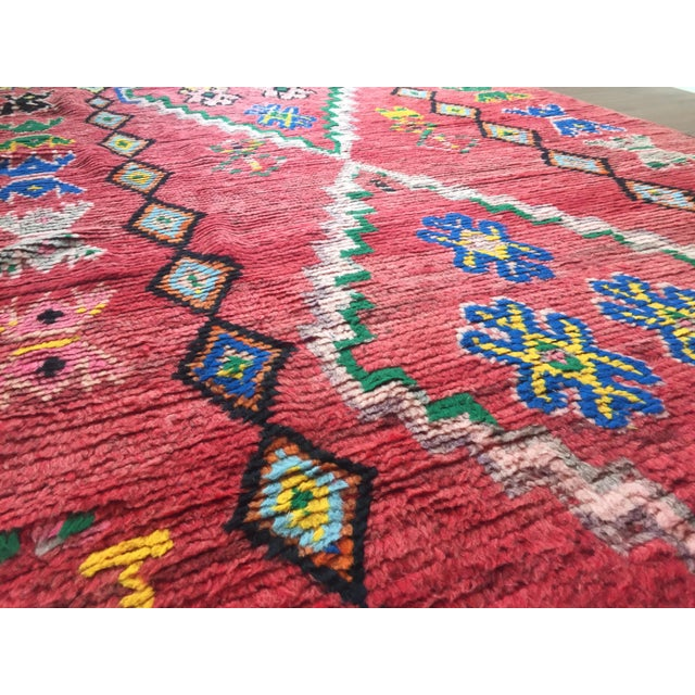 This beautiful Moroccan rug is in excellent condition and is a definite show stopper. The rug has a soft red field with...