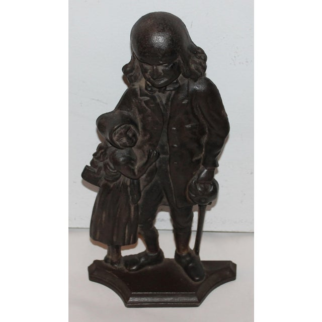 This great cast iron door stop is an amazing crafted item. The details on this door stop are amazing. Benjamin Franklin...